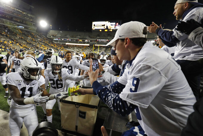 Penn State celebrates a 17-12 victory over Iowa with fans following the NCAA college football game Saturday, Oct. 12, 2019, in Iowa City, Iowa. (AP Photo/Matthew Putney)