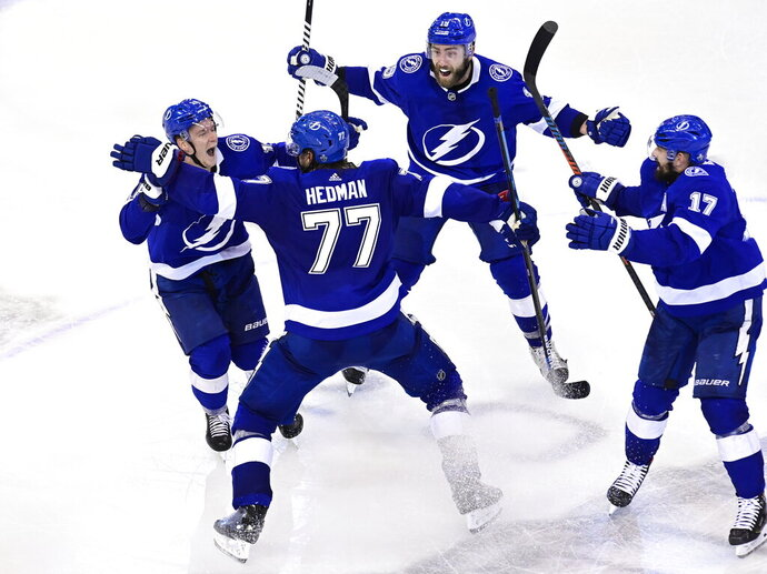 Tampa Bay Lightning defenseman Victor Hedman (77) celebrates his winning goal against the Boston Bruins with teammates Ondrej Palat (18), Patrick Maroon (14) and Alex Killorn (17) during the second overtime period of NHL Stanley Cup Eastern Conference playoff hockey game action in Toronto, Monday, Aug. 31, 2020. (Frank Gunn/The Canadian Press via AP)