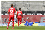 Moenchengladbach's Marcus Thuram, second left, scores his side's third goal during the German Bundesliga soccer match between Borussia Moenchengladbach and Union Berlin in Moenchengladbach, Germany, Sunday, May 31, 2020. The German Bundesliga becomes the world's first major soccer league to resume after a two-month suspension because of the coronavirus pandemic. (AP Photo/Martin Meissner, Pool)