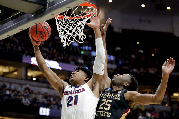 Gonzaga forward Rui Hachimura, left, shoots next to Florida State forward Mfiondu Kabengele during the first half an NCAA men's college basketball tournament West Region semifinal Thursday, March 28, 2019, in Anaheim, Calif. (AP Photo/Jae C. Hong)
