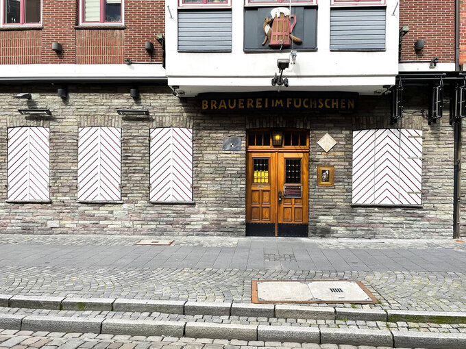 The restaurant of the Fuechschen brewery is closed in Duesseldorf, Germany, Tuesday, March 23, 2021, where about 6,000 litres of its renowned copper-colored 'Altbier' remain unsold and nearing its expiry date.  The brewery now works with craft bakers who use the beer to make bread, with about twelve bakeries producing the grain bread and are giving the additional bonus of a bottle of Fuechschen's Altbier free of charge with every loaf.(AP Photo/Daniel Niemann)