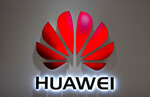 FILE - In this July 4, 2018, file photo, the Huawei logo is seen at a Huawei store at a shopping mall in Beijing. China has called on the United States to 'stop the unreasonable crackdown' on Huawei following the tech giant's indictment on charges of stealing technology, violating trade sanctions and lying to banks. (AP Photo/Mark Schiefelbein, File)