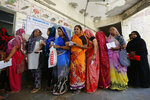 Indian women stand in queue to cast their vote for general election in Ahmadabad, India, Tuesday, April 23, 2019. Indians are voting Tuesday in the third phase of the general elections with campaigning by Prime Minister Narendra Modi's Hindu nationalist party and the opposition marred by bitter accusations and acrimony. The voting over seven phases ends May 19, with counting scheduled for May 23. (AP Photo/Ajit Solanki)