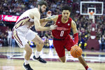 Louisville guard Lamarr Kimble (0) gets past Florida State center Dominik Olejniczak (15) in the first half of an NCAA college basketball game in Tallahassee, Fla., Monday, Feb. 24, 2020. (AP Photo/Mark Wallheiser)