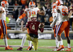 Boston College quarterback EJ Perry (4) rises from the turf after being tackled during the second half of the team's NCAA college football game against Clemson, Saturday, Nov. 10, 2018, in Boston. (AP Photo/Elise Amendola)