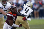 Georgia Tech quarterback James Graham (4) is sacked by Virginia Tech defensive lineman DaShawn Crawford (36) in the first half of an NCAA football game Saturday, Nov. 16, 2019, in Atlanta. (AP Photo/John Bazemore)
