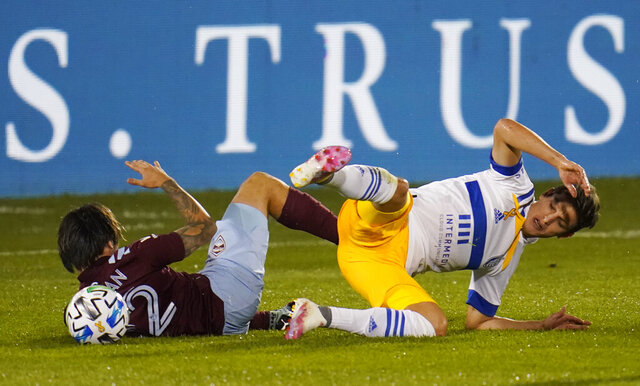 San Jose Earthquakes midfielder Carlos Fierro, right, collides with Colorado Rapids midfielder Braian Galvan during the first half of an MLS soccer match, Wednesday, Sept. 23, 2020, in Commerce City, Colo. (AP Photo/David Zalubowski)
