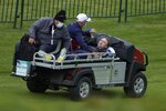Actor Tom Felton is helped after collapsing on the 18th hole during a practice day at the Ryder Cup at the Whistling Straits Golf Course Thursday, Sept. 23, 2021, in Sheboygan, Wis. (AP Photo/Ashley Landis)