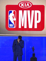 NBA player Giannis Antetokounmpo, of the Milwaukee Bucks, reacts as he accepts the most valuable player award at the NBA Awards on Monday, June 24, 2019, at the Barker Hangar in Santa Monica, Calif. (Photo by Chris Pizzello/Invision/AP)