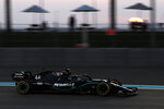 Mercedes driver Lewis Hamilton of Britain steers his car during the second free practice at the Yas Marina racetrack in Abu Dhabi, United Arab Emirates, Friday, Dec. 11, 2020. The Emirates Formula One Grand Prix will take place on Sunday. (Hamad Mohammed, Pool via AP)