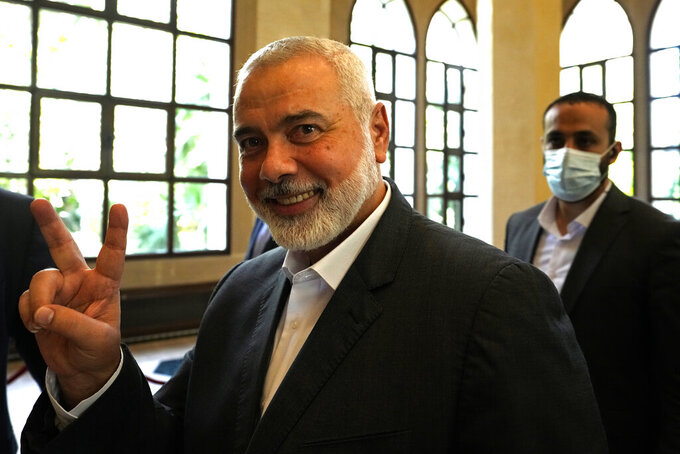 FILE - In this June 28, 2021 file photo, Ismail Haniyeh, the leader of the Palestinian militant group Hamas, flashes the victory sign after his meeting with Lebanese Parliament Speaker Nabih Berri, in Beirut, Lebanon. Hamas on Sunday, Aug. 1, 2021, said it has re-elected Haniyeh as its supreme leader. Haniyeh, who has been living in exile for the past two years, was given a new four-year term by the Shura Council, the Islamic group's top decision-making body. He was unopposed. (AP Photo/Hassan Ammar, File)
