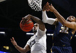 Xavier forward Naji Marshall (13) rebounds the ball in front of Toledo guard Chris Darrington (32) during the second half of a first-round NIT college basketball game Wednesday, March 20, 2019, in Cincinnati. (AP Photo/Gary Landers)