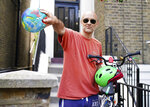 Britain's Prime Minister Boris Johnson's senior aid Dominic Cummings leaves his north London home, in London, Saturday May 23, 2020. The British government faced accusations of hypocrisy on Saturday after the revelation that Prime Minister Boris Johnson's top adviser Cummings, traveled more than 250 miles (400 kms) to his parents' house during a nationwide lockdown while he was showing coronavirus symptoms. (Aaron Chown/PA via AP)