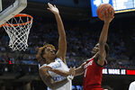 North Carolina State guard Markell Johnson (11) drives to the basket against North Carolina forward Armando Bacot during the second half of an NCAA college basketball game in Chapel Hill, N.C., Tuesday, Feb. 25, 2020. (AP Photo/Gerry Broome)
