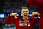 Wisconsin's Brad Davison celebrates after a teammate was fouled by Michigan State player during the first half of an NCAA college basketball game Saturday, Feb. 1, 2020, in Madison, Wis. Davison is serving a one-game suspension. (AP Photo/Andy Manis)