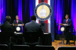 Democratic State Attorney General Jim Hood, left and Republican Lt. Gov. Tate Reeves, right, listen to a question from one of the two moderators during the first televised gubernatorial debate at the University of Southern Mississippi in Hattiesburg, Miss., Thursday, Oct. 10, 2019. (AP Photo/Rogelio V. Solis, Pool)