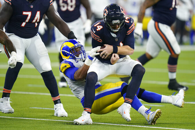 Chicago Bears quarterback Andy Dalton is hauled down by Los Angeles Rams defensive end Aaron Donald during the second half of an NFL football game Sunday, Sept. 12, 2021, in Inglewood, Calif. (AP Photo/Jae C. Hong)
