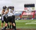 Teammates celebrate with Appalachian State wide receiver Thomas Hennigan, left, after a touchdown against South Alabama during the first half of an NCAA college football game Saturday, Oct. 26, 2019, at Ladd-Peebles Stadium in Mobile, Ala. (AP Photo/Julie Bennett)