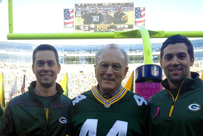 In this October 2012 photo provided by Karen Gooch, former Green Bay Packers football player Bobby Dillon is shown flanked by his grandsons Dillon Gooch, left and Weston Gooch during ceremonies at Lambeau Field in Green Bay, Wisc. Dillon passed away at age 89 in August 2019, five months before he was selected for the Hall of Fame as part of the centennial class. (Karen Gooch via AP)