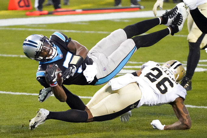 Carolina Panthers quarterback Teddy Bridgewater is tackled by New Orleans Saints cornerback P.J. Williams during the first half of an NFL football game Sunday, Jan. 3, 2021, in Charlotte, N.C. (AP Photo/Gerry Broome)