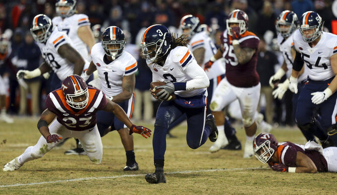 Virginia quarterback Bryce Perkins (3) runs the ball while pursued by the Virginia Tech defense during the first half of an NCAA college football game in Blacksburg, Va., Friday, Nov. 23, 2018. (Matt Gentry/The Roanoke Times via AP)