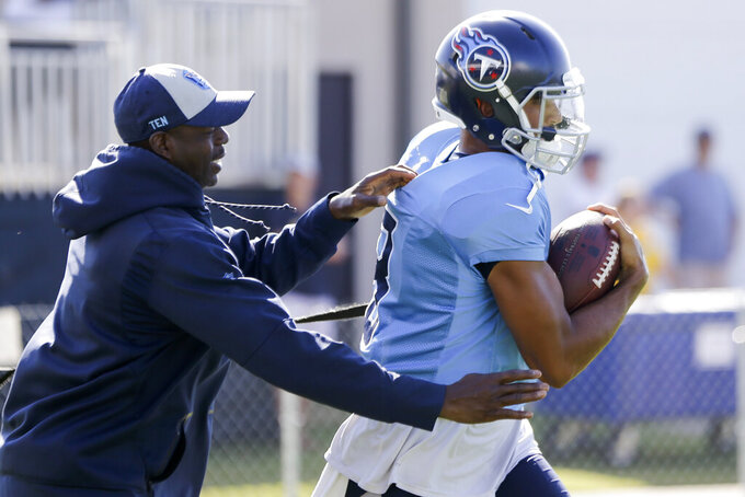 Tennessee Titans quarterback Marcus Mariota runs a drill during a combined NFL football training camp with the New England Patriots Thursday, Aug. 15, 2019, in Nashville, Tenn. (AP Photo/Mark Humphrey)
