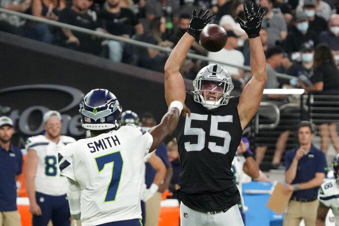 Las Vegas Raiders linebacker Tanner Muse (55) knocks down a pass thrown by Seattle Seahawks quarterback Geno Smith (7) during the first half of an NFL preseason football game, Saturday, Aug. 14, 2021, in Las Vegas. (AP Photo/Rick Scuteri)