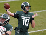 FILE - In this Dec. 5, 2020, file photo, Michigan State quarterback Payton Thorne (10) throws a pass against Ohio State during an NCAA college football game, Saturday, Dec. 5, 2020, in East Lansing, Mich. Michigan State still has uncertainty at quarterback, and coach Mel Tucker is in no rush to clarify it. Anthony Russo, a transfer from Temple, joins the mix this offseason, and Thorne is back after playing four games as a redshirt freshman. (AP Photo/Al Goldis, File)