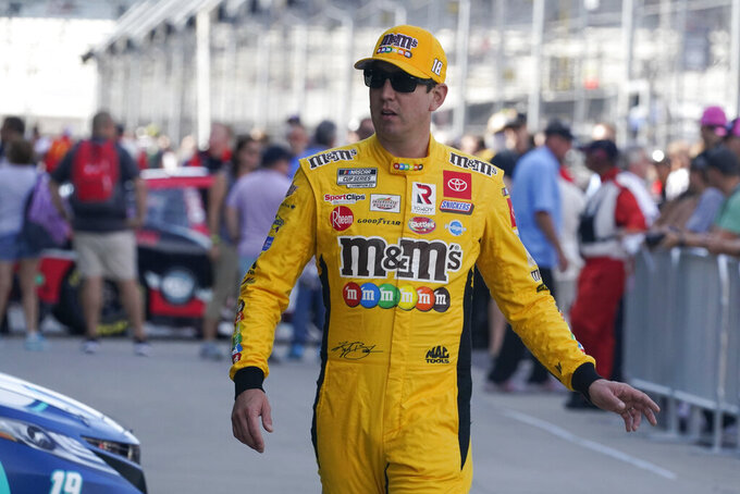 Kyle Busch walks tp his garage during practice for the NASCAR Cup Series at Indianapolis Motor Speedway, Saturday, Aug. 14, 2021, in Indianapolis. (AP Photo/Darron Cummings)