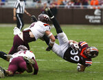 Virginia Tech tight end Drake Deluliis (89) gets up ended by defenders Dax Hollifield (4) and Jermaine Waller (28) during the NCAA college football team's Maroon-White spring game in Blacksburg, Va., Saturday, April 13, 2019. (Matt Gentry/The Roanoke Times via AP)