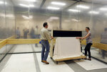 Collections manager/registrar Michelle Moskal, right, and curator Mark Turdo move the covered Commander-in-Chief's Standard in a freight elevator to an exhibition gallery, Wednesday, June 13, 2018, at the Museum of the American Revolution in Philadelphia. The faded and fragile blue silk flag marked General George Washington's presence on the battlefield during the Revolutionary War. The museum is bringing the flag out of its archives for public viewing on Thursday, June 14, Flag Day, until Sunday. Its appearance at the museum is the flag's first public display in Philadelphia since the war. (AP Photo/Jacqueline Larma)