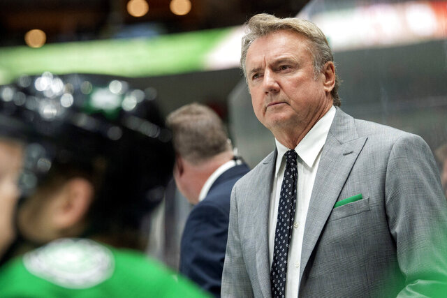 FILE- In this Dec. 10, 2019, file photo, Dallas Stars interim head coach Rick Bowness watches play from behind the bench during the third period of an NHL hockey game against the New Jersey Devils in Dallas. The Stars, on Thursday, Oct. 29, 2020, have officially removed the interim tag from Bowness, the coach who led them to the Stanley Cup Final. (AP Photo/Jeffrey McWhorter, File)
