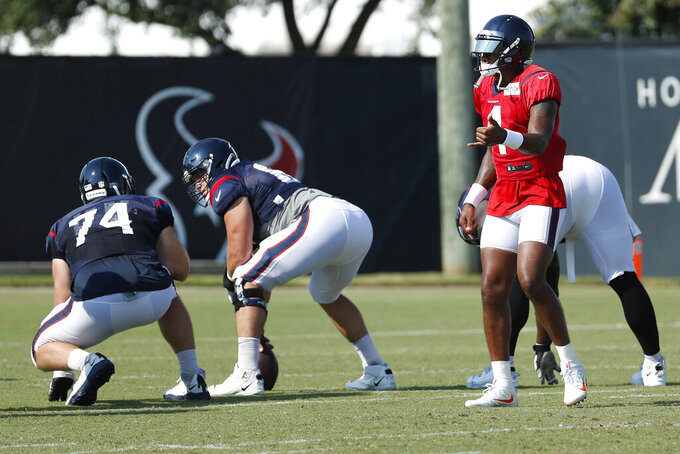 Houston Texans quarterback Deshaun Watson (4) calls out a play during an NFL training camp football practice Sunday, Aug. 23, 2020, in Houston. (Brett Coomer/Houston Chronicle via AP, Pool)
