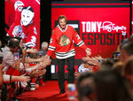 FILE - In this July 15, 2016, file photo, Chicago Blackhawks great Tony Esposito is introduced to the fans during the Blackhawks' convention in Chicago. Esposito, a Hall of Fame goaltender who played almost his entire 16-year career with the Blackhawks, has died following a brief battle with pancreatic cancer, the team announced Tuesday, Aug. 10, 2021. He was 78. (AP Photo/Charles Rex Arbogast, File)