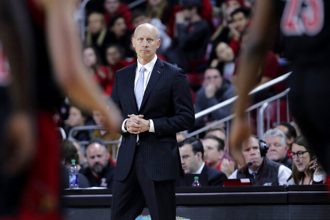 Louisville coach Chris Mack watches his players during the first half of an NCAA college basketball game against Boston College in Boston, Wednesday, Jan. 29, 2020. (AP Photo/Charles Krupa)