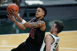 Rutgers guard Jacob Young (42) makes a layup as Michigan State guard Foster Loyer (3) defends during the first half of an NCAA college basketball game, Tuesday, Jan. 5, 2021, in East Lansing, Mich. (AP Photo/Carlos Osorio)