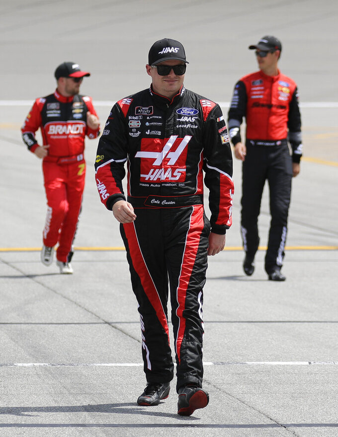 Cole Custer walks to his car before the NASCAR Xfinity Series auto race at Chicagoland Speedway in Joliet, Ill., Saturday, June 29, 2018. (AP Photo/Nam Y. Huh)