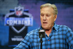 FILE - In this Feb. 25, 2020, file photo, Denver Broncos president of football operations and general manager John Elway speaks during a press conference at the NFL football scouting combine in Indianapolis. Elway has selected a defensive player with his first draft pick six times in his nine drafts. (AP Photo/Michael Conroy, File)
