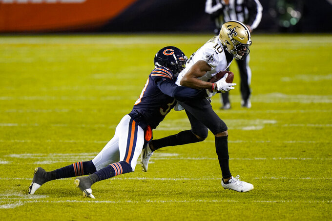 Chicago Bears cornerback Kyle Fuller (23) tackles New Orleans Saints wide receiver Tre'Quan Smith (10) in the second half of an NFL football game in Chicago, Sunday, Nov. 1, 2020. (AP Photo/Nam Y. Huh)