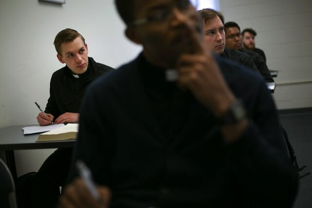 Seminarian Daniel Rice, left, sits with classmates during a lesson on the Gospel of Luke at St. Charles Borromeo Seminary in Wynnewood, Pa., on Wednesday, Feb. 5, 2020. Future Catholic priests remain unflinchingly optimistic despite scandals that have driven faithful from the pews. (AP Photo/Wong Maye-E)