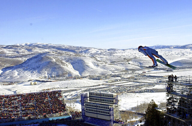 FILE - In this Feb. 10, 2002, file photo, Simon Ammann, of Switzerland, competes in the men's K90 Individual ski jump at the 2002 Salt Lake City Winter Olympics in Park City, Utah.  Salt Lake City may shift its focus to bidding for the 2034 Winter Olympics rather than the games four years earlier following the announcement last month that Sapporo, Japan will bid for 2030, organizing committee members said Wednesday, Feb. 12, 2020. (AP Photo/Elise Amendola, File)