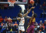 Minnesota center Daniel Oturu, right, shoots over Oklahoma State forward Kalib Boone during an NCAA college basketball game Saturday, Dec. 21, 2019, in Tulsa, Okla. (Brett Rojo/Tulsa World via AP)