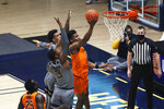 Oklahoma State forward Matthew-Alexander Moncrieffe (12) shoots while defended by West Virginia forward Gabe Osabuohien (3) during the first half of an NCAA college basketball game Saturday, March 6, 2021, in Morgantown, W.Va. (AP Photo/Kathleen Batten)
