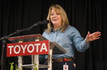 Toyota Motor Manufacturing West Virginia President Leah Curry announces a building expansion at the plant on Thursday, March 14, 2019, at Toyota Motor Manufacturing in Buffalo, W.Va. Toyota Motor Corp. on Thursday announced it is investing an additional $750 million at five U.S. plants. (Sholten Singer/The Herald-Dispatch via AP)
