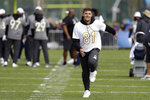NFC tight end Austin Hooper, of the Atlanta Falcons, laughs as he runs a route during a practice for the NFL Pro Bowl football game Wednesday, Jan. 22, 2020, in Kissimmee, Fla. (AP Photo/Chris O'Meara)