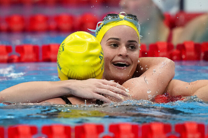 Kaylee Mckeown, of Australia, embraces teammate Emily Seebohm after winnning the gold medal in the women's 200-meter backstroke final at the 2020 Summer Olympics, Saturday, July 31, 2021, in Tokyo, Japan. (AP Photo/David Goldman)