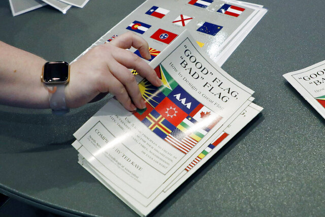 A member of the state Department of Archives and History prepares a handout of materials on how to design a flag for members, following the first meeting of the Flag Commission, Wednesday, July 22, 2020, in Jackson, Miss. The group has the duty to design a new Mississippi flag without the Confederate battle emblem and the banner must include the phrase,