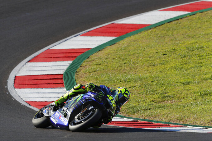 MotoGP rider Valentino Rossi of Italy steers his motorcycle during the MotoGP race of the Portuguese Motorcycle Grand Prix, the last race of the season, at the Algarve International circuit near Portimao, Portugal, Sunday, Nov. 22, 2020. (AP Photo/Armando Franca)