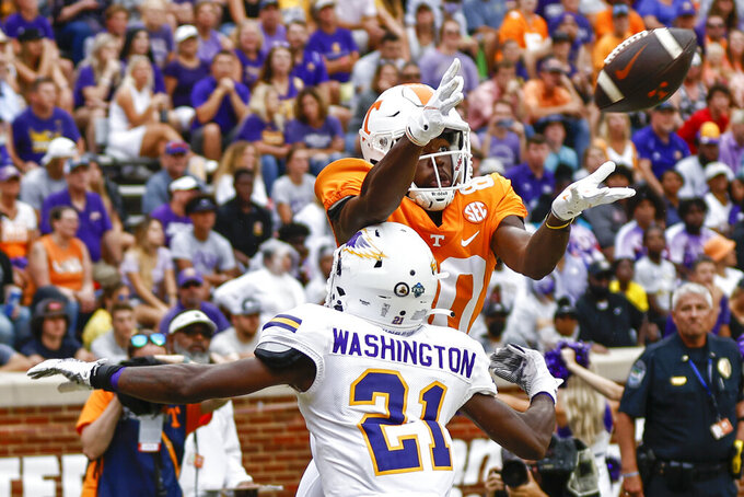Tennessee wide receiver Ramel Keyton (80) tries to make a catch as he's defended by Tennessee Tech defensive back Nyquan Washington (21) during the second half of an NCAA college football game Saturday, Sept. 18, 2021, in Knoxville, Tenn. (AP Photo/Wade Payne)