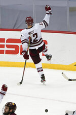 Massachusetts' Garrett Wait (12) celebrates after scoring against Minnesota Duluth during overtime in an NCAA men's Frozen Four hockey semifinal in Pittsburgh, early Friday, April 9, 2021. Massachusetts won 3-2 and will face St. Cloud State in the championship game Saturday. (AP Photo/Keith Srakocic)